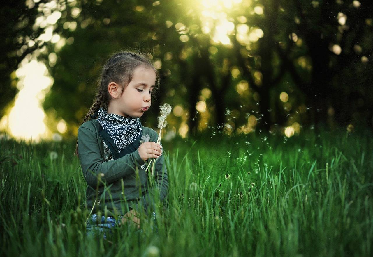 girl blowing dandelion 1280x853